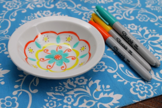 permanent marker drawing on dishes